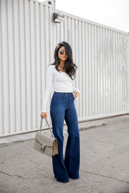 Street style | High waisted flared jeans over striped shirt | High .