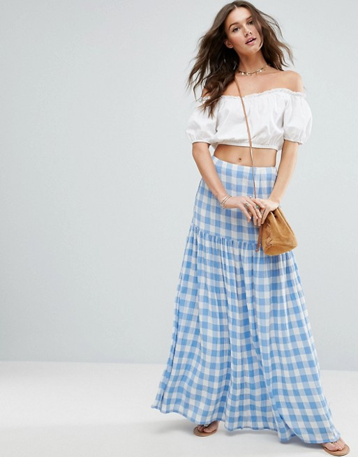 high-waisted maxi skirt from the shoulder-cut blouse