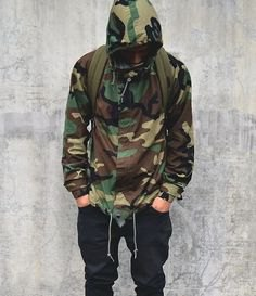 Hooded camo windbreaker with black baggy jeans