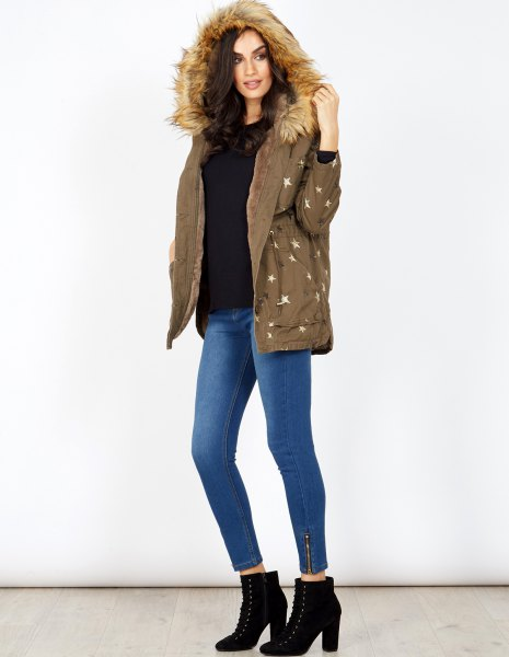 Hooded parka coat with black sweater and boots