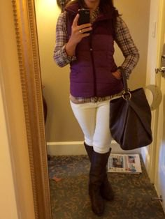 purple vest with hood and plaid shirt and white jeans