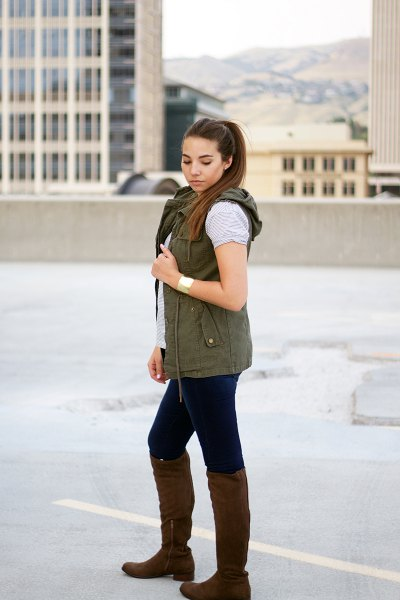 Hooded vest with gray t-shirt and knee-high boots