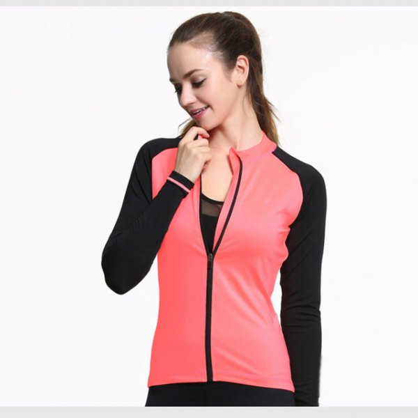 pink and black sports blazer with a semi-transparent tank top with a scoop neckline