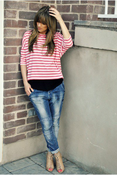 pink and white striped long-sleeved T-shirt with blue tied jeans