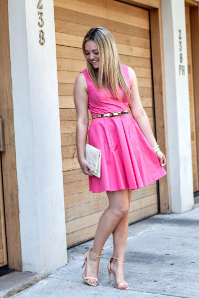 sleeveless swing dress with pink belt and strappy heels
