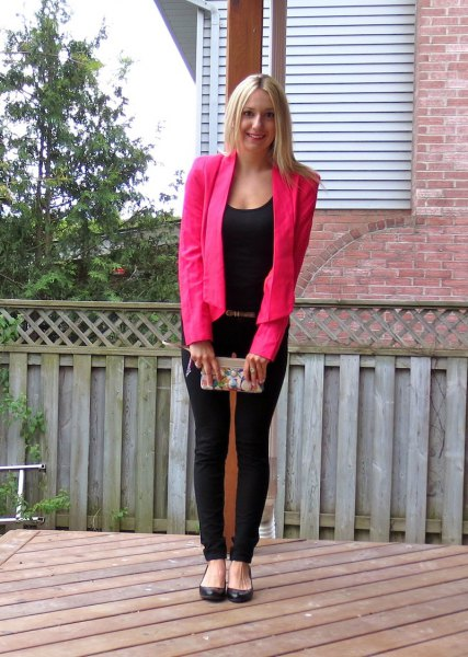 pink blazer with a completely black outfit