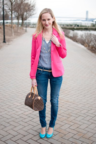 pink blazer with a blue polka dot blouse with a V-neckline and skinny jeans