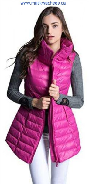 Pink-colored long down vest with gray, ribbed, figure-hugging sweater