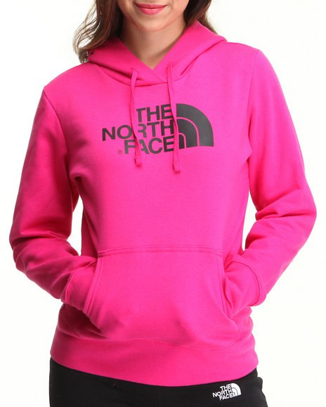 Pink-colored North Face pullover hoodie with black sport nylon pants