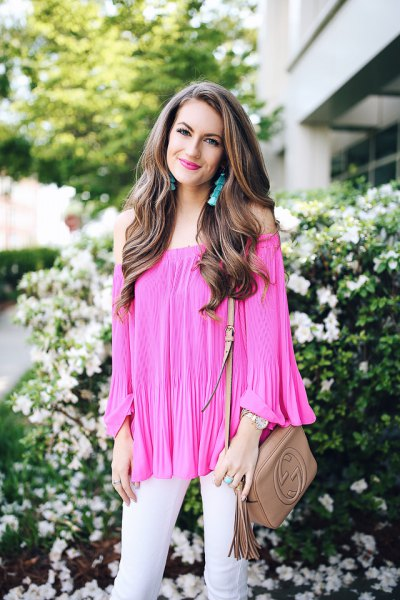 Hot pink blouse with pleated off the shoulder and white skinny jeans