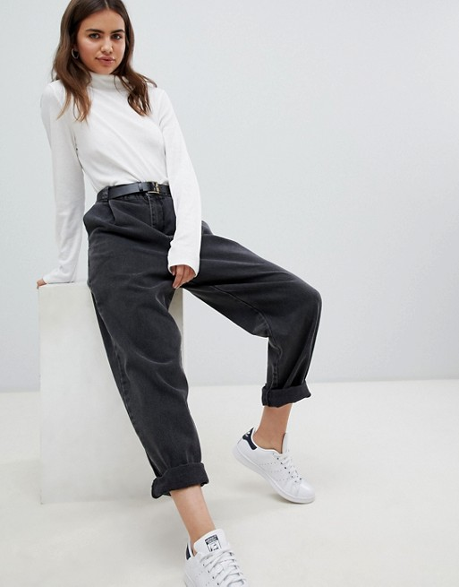 ASOS DESIGN tapered boyfriend jeans with curved seams and belt in .