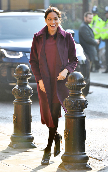 Meghan Markle stuns in a burgundy dress and coat by Club Monaco on .