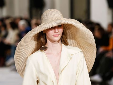 How the oversized straw hat became this summer's key accessory .