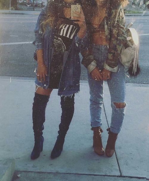 camo jacket, blue knee ripped jeans, and black thigh high boots .