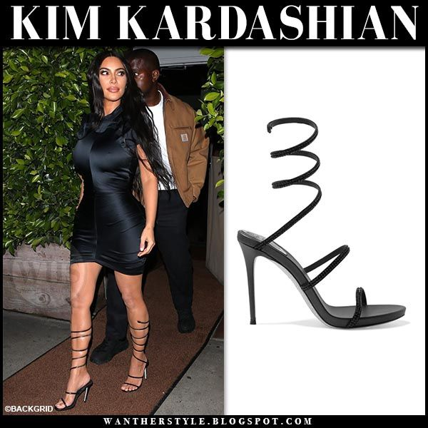 Kim Kardashian in black strappy sandals and black mini dress at .