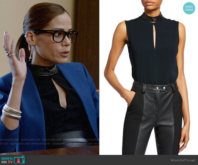 Amanda's black keyhole top with leather neck on Almost Family in .