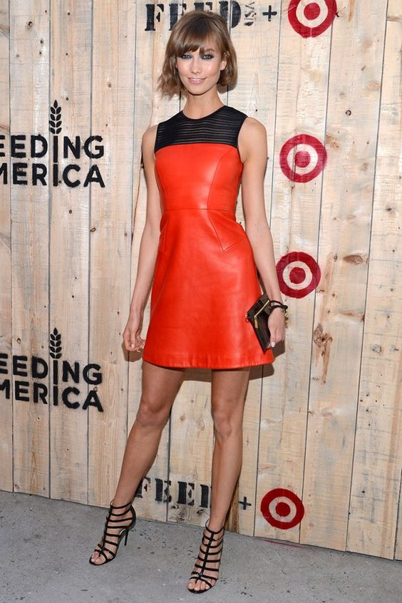 Picture Of Karlie Kloss wearing a sheath red leather dress with a .
