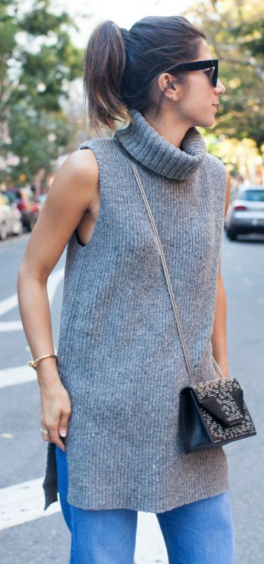 A thick knitted sleeveless turtleneck will look great worn with .