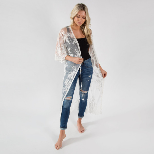 Lightweight white lace kimono with waist tie. One size fits most 0 .
