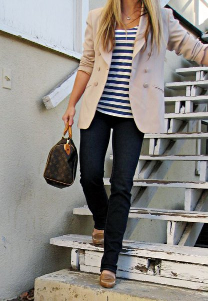 Ivory blazer with a striped t-shirt and dark blue jeans