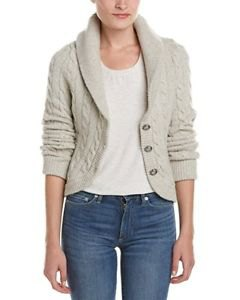 Ivory cable knit blazer with white scoop neck top and blue jeans