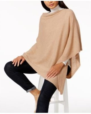 Ivory cashmere poncho over white mock neck sweater