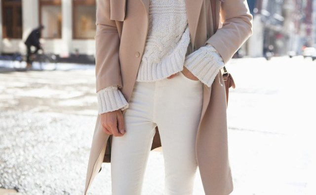 chunky ivory sweater with red coat and cream-colored jeans