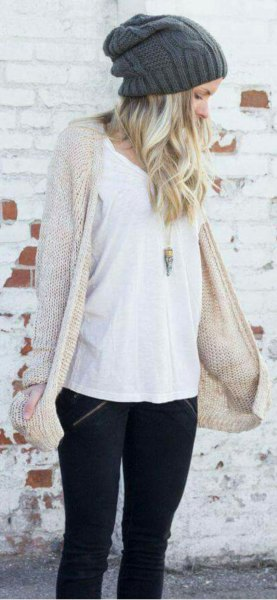 Ivory knit long cardigan with black skinny jeans