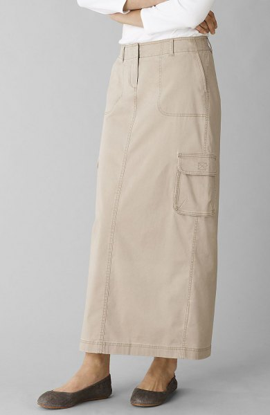 Ivory long khaki skirt with straight cut and white long-sleeved top