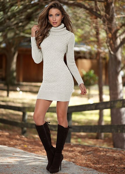 Ivory turtleneck bodycon sweater dress with black knee high boots