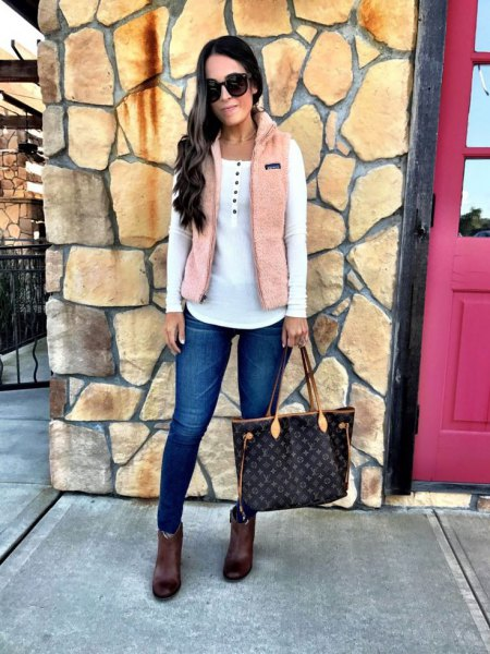 Ivory vest over white ankle boots
