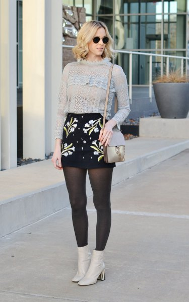 Knit sweater, high waisted embroidered skirt