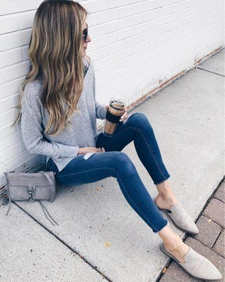 Knit sweater with dark blue skinny jeans and gray suede shoes