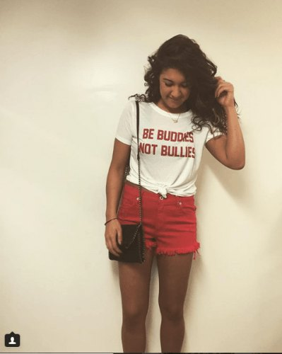 knotted graphic t-shirt with red mini denim shorts