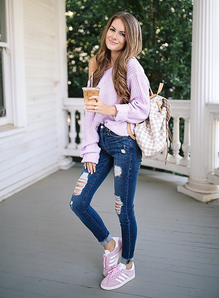 chunky one shoulder ribbed lavender sweater and blue jeans