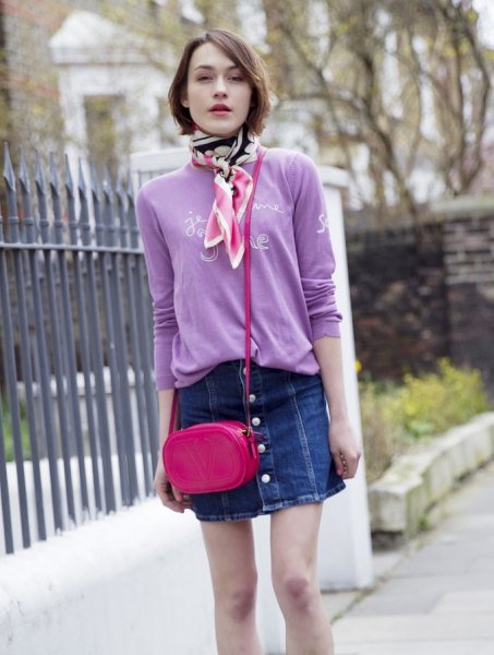 Sweater with lavender print and denim skirt with button placket in front