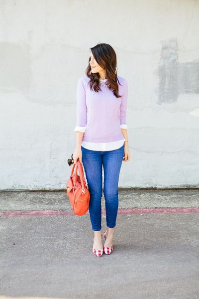 Lavender sweater over white buttoned shirt