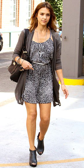 Leather ankle boots with a black and white leopard print mini dress and belt