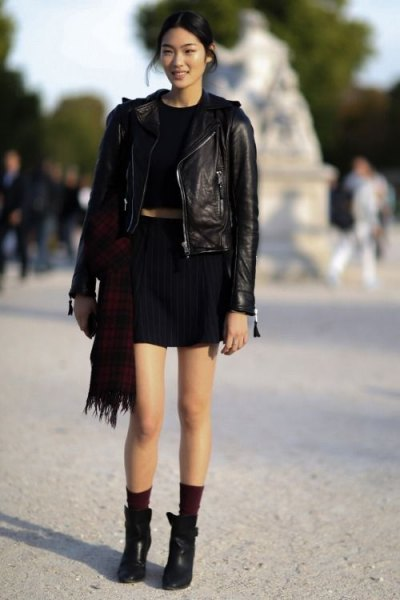 Leather jacket with black T-shirt and mini skirt