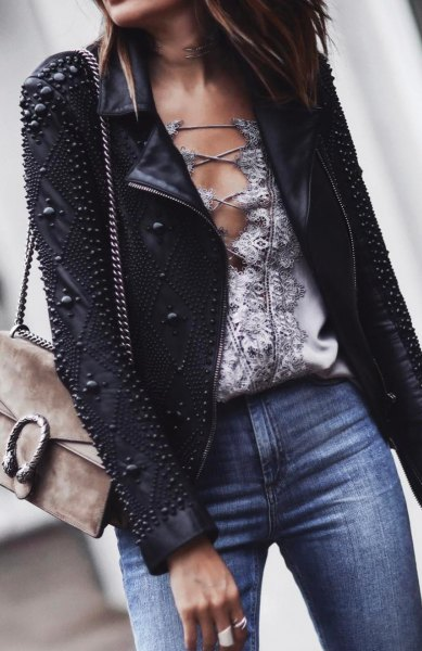 Leather jacket with black studs and blue jeans