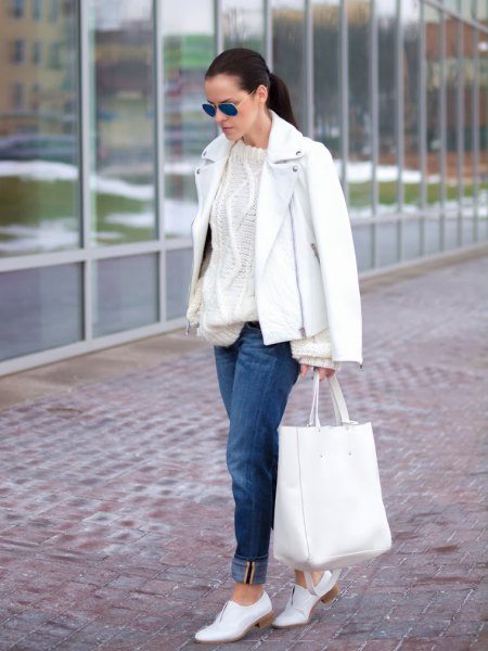 Leather jacket with a cable knit sweater and white shoes