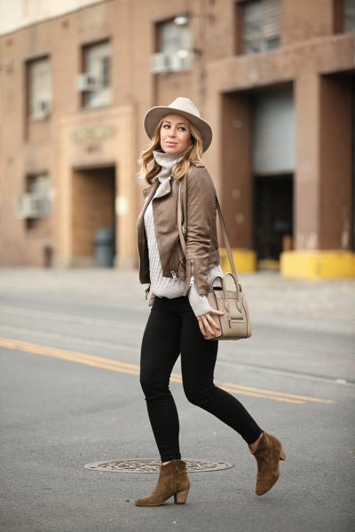 Leather jacket with a gray turtleneck and a white felt hat