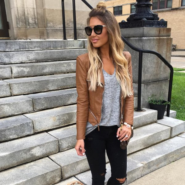 Leather jacket with a heather gray V-neck tank top and ripped jeans