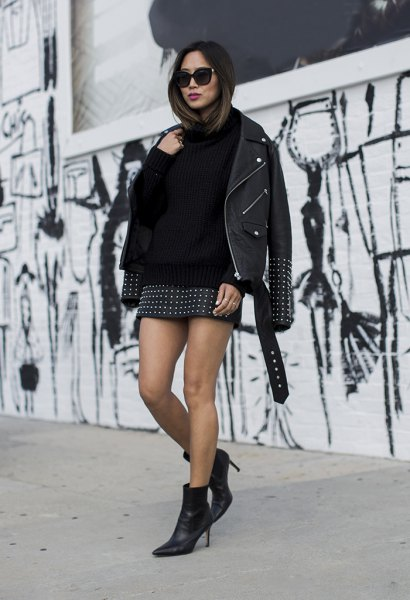 Leather jacket with sweater and black mini skirt with rivets