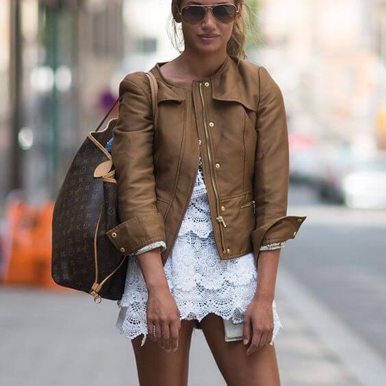 Leather jacket with white lace mini dress