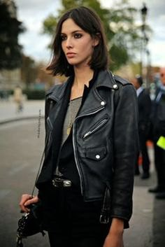 Leather motorcycle jacket with black vest and gray top