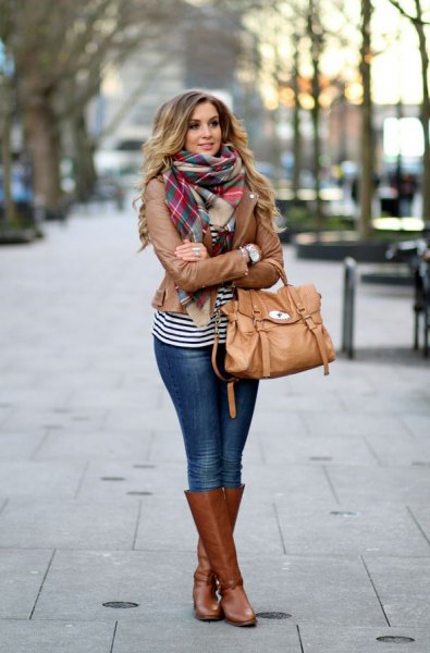 Leather motorcycle jacket with a checked scarf and knee-high boots