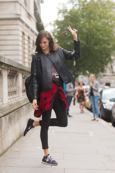 Leather motorcycle jacket with a red and black checked boyfriend shirt around the waist
