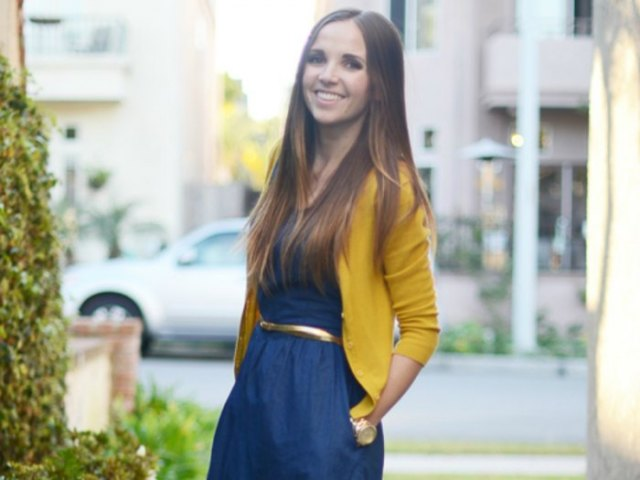 Lemon yellow cardigan with a dark blue ruffled dress with a belt and a flared belt