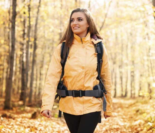 Lemon yellow oversized hiking jacket with black skinny jeans